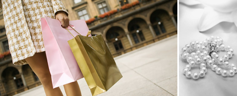 woman with shopping bags and pearls